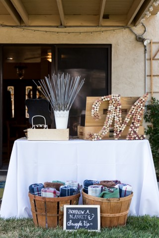 Backyard wedding reception with blankets for wedding guests and sparkler send offs