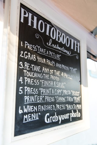 Instruction board for photobooth at backyard wedding reception