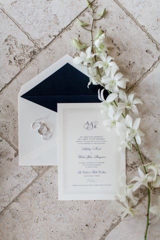 White elegant invitations by The Paper Shop in Winter Park, Florida