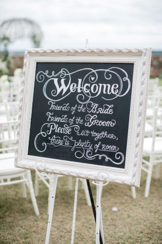 Elegant white ornate chalk board for welcome wedding sign