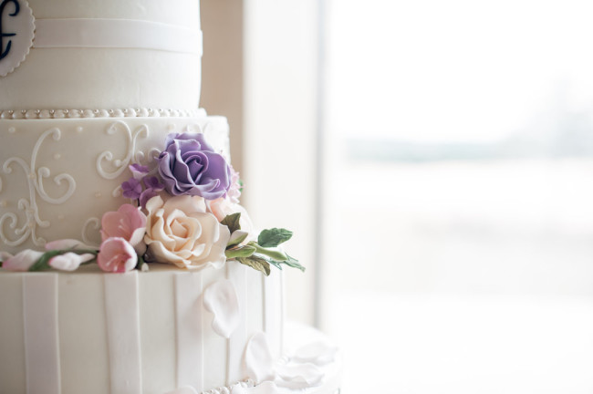 White, purple, and pink wedding cake created by Sprinkles
