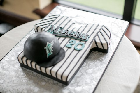 Mariners jersey themed wedding cake created by Sprinkles