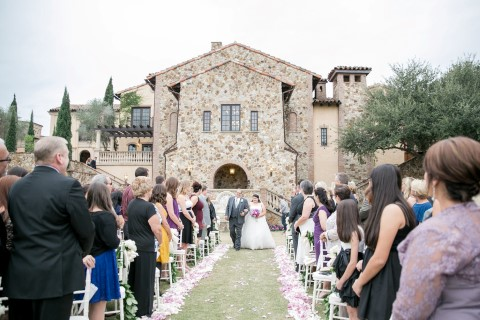 Bride walking down the aisle with father at Bella Collina
