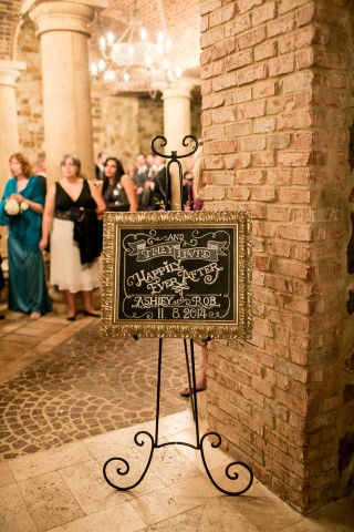 Ornate gold chalkboard sign that says Happily Ever After for wedding sign