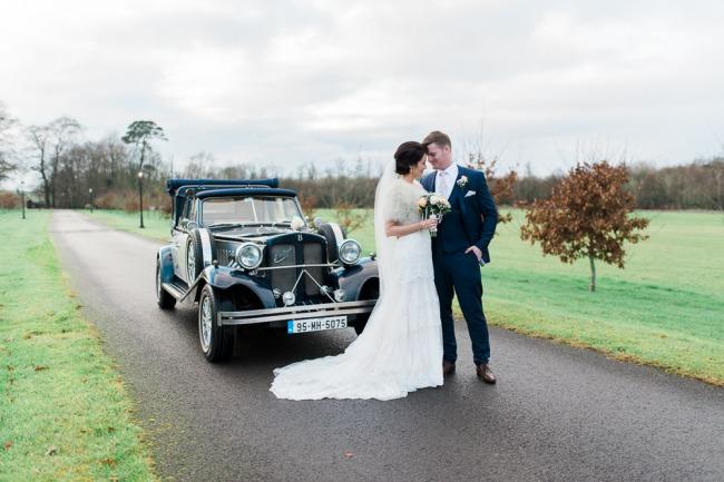 Newlyweds-beside-Darver-Castle-vintage-car
