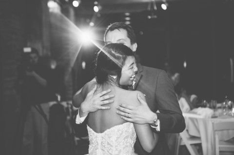 Black and white photo of bride and groom dancing captured by Ashley West Photography, LLC