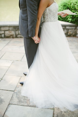 Bride and groom back to back for first looks captured by Ashley West Photography, LLC