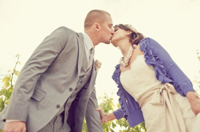 bride wearing a violet color cardigan