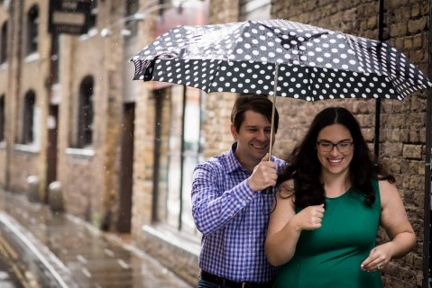 Engagement shoot in London with black and white polka-dot umbrella