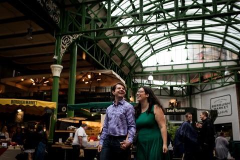 Engaged couple walking through borough market in London captured by Matt Badenoch
