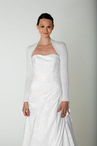 model in white bolero and gown