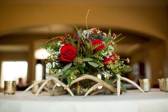 Winter wedding reception with a antler floral center piece