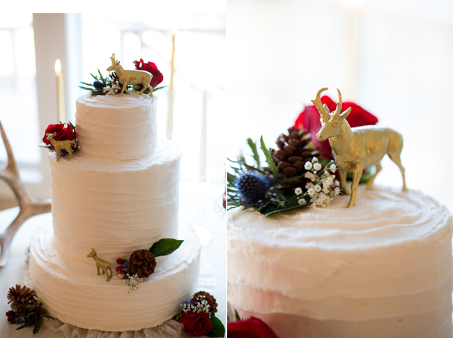 White wedding cake with gold stags