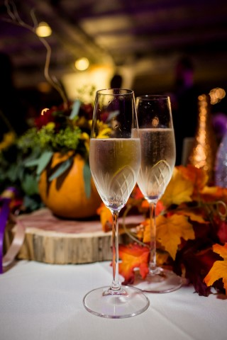 Two champagne glasses for fall themed wedding reception