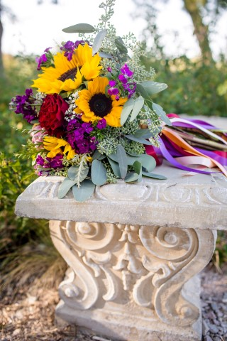 Fall themed wedding bouquet created by HEB Blooms with sun flowers and ribbons