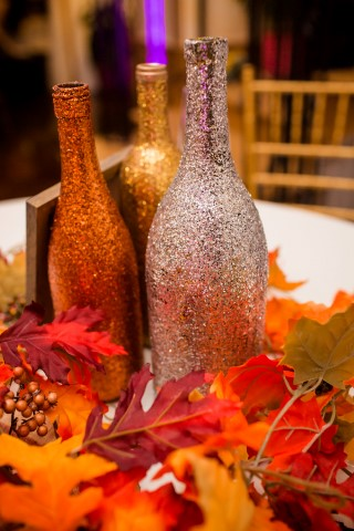 Silver, gold, and bronze glittered wine bottles for fall themed wedding