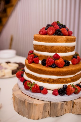Rustic naked cake for wedding reception created by Michelle's Patisserie