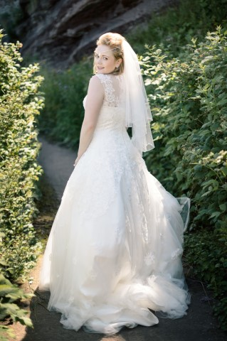 Bride wearing lace gown and veil captured by Crofts & Kowalczyk Photography
