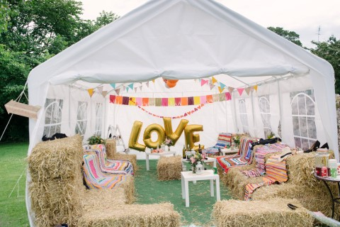 Inspired beach festival wedding in scotland outdoor wedding reception with a tent hay bales and bunting at tyninghame village hall junglespirit Images