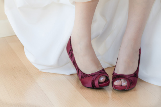 Bride wearing red peep toe pumps