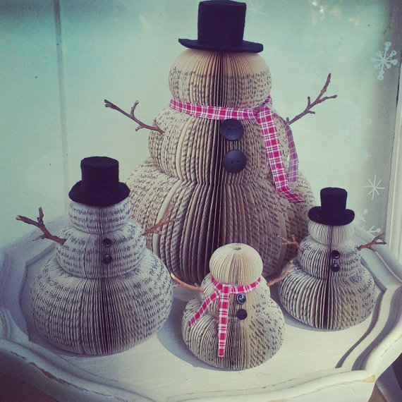 vintage set of snow men made out of book pages