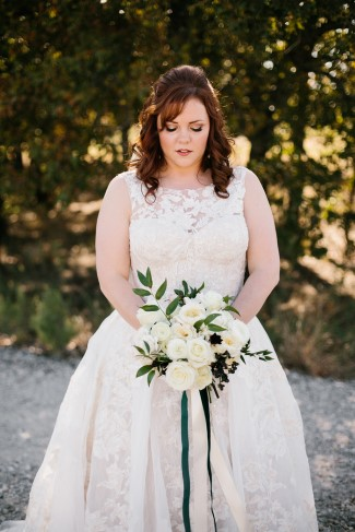Bride holding a bouquet with long hanging ribbons