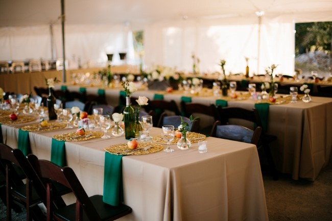 Tented backyard wedding reception with a forest green theme