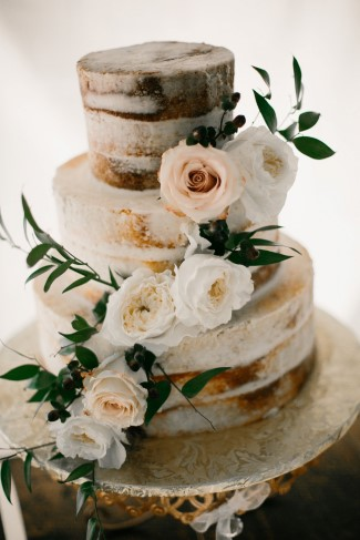 Naked cake with white and pink roses created by Legacy Cakes