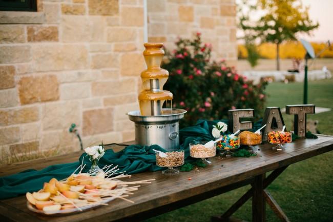 Wedding reception dessert table with caramel fountain
