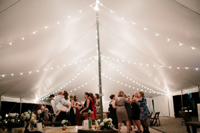 White tent wedding reception for backyard wedding