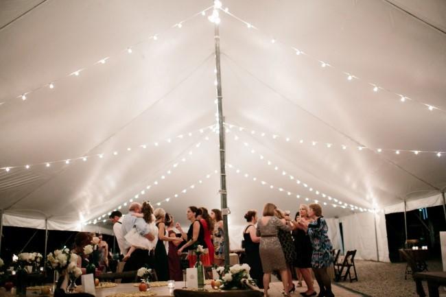 White tent wedding reception for backyard wedding