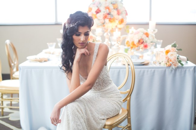 Bride posing with hair curled and swept to the side created by Jojo Tsang
