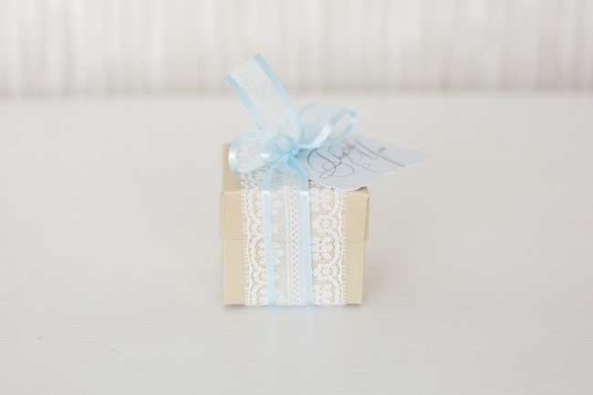 Small wedding favor box wrapped with blue ribbon and lace