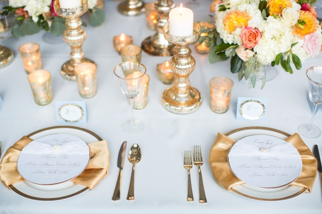 Gold themed place setting with light blue table cloth