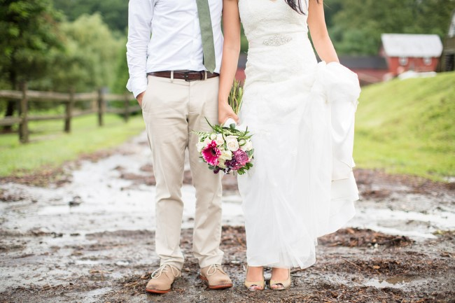 Bride and groom standing in the mud of Genesee Valley wedding venue captured by Anna Grace Photography