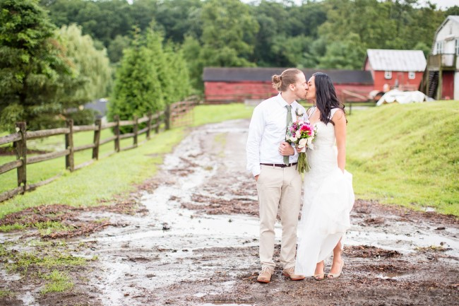 Bride and groom standing in the mud kissing at Genesee Valley captured by Anna Grace Photography