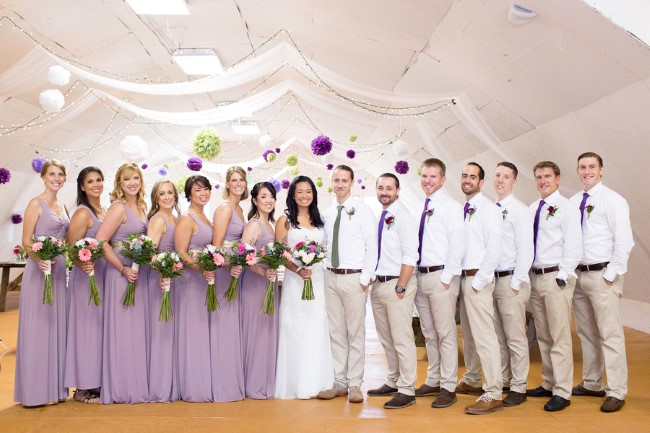 Bride and groom standing with wedding party captured by Anna Grace Photography