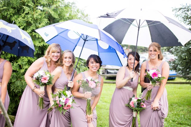 bridal party under umbrellas