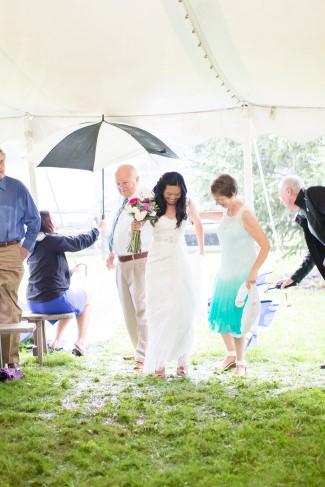 bride walking down aisle in the mud