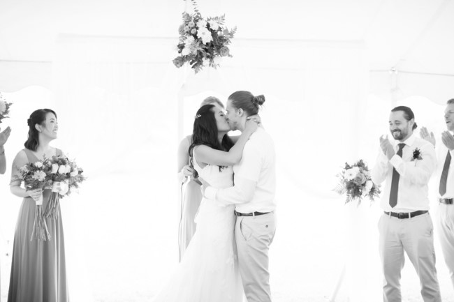 Black and white photo of bride and groom kissing captured by Anna Grace Photography