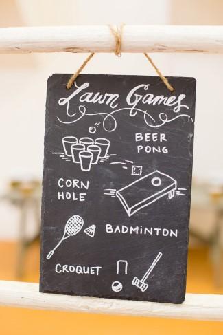 Chalkboard sign describing lawn games for wedding
