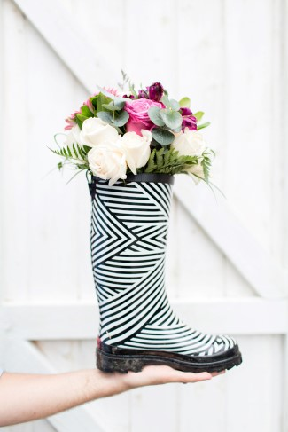 Rain boot with flowers in it for outdoor wedding in the rain