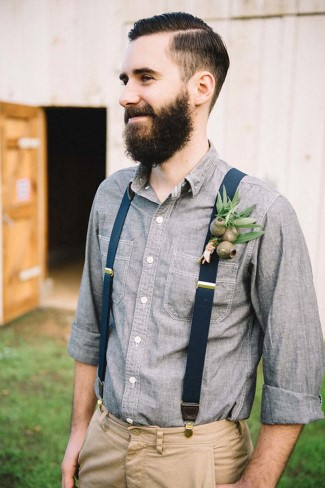 Groom wearing a boutonniere created from Petals of Love