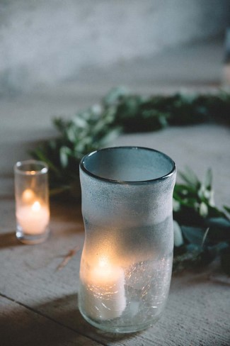 Votive candles places on the floor for wedding ceremony