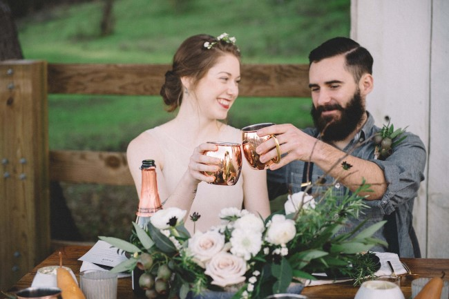 Bride and groom clinking cups captured by Love in Photographs