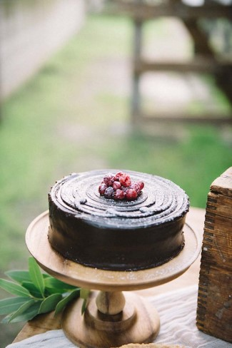 Chocolate black cakes with berries on top