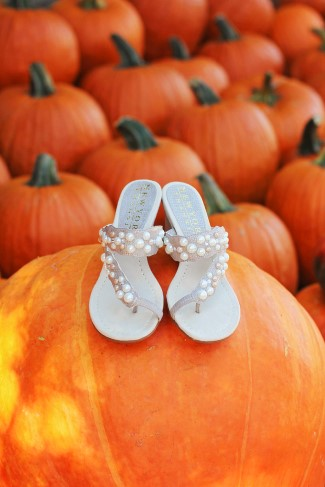 Bridal sandles with pearls on a pumkin