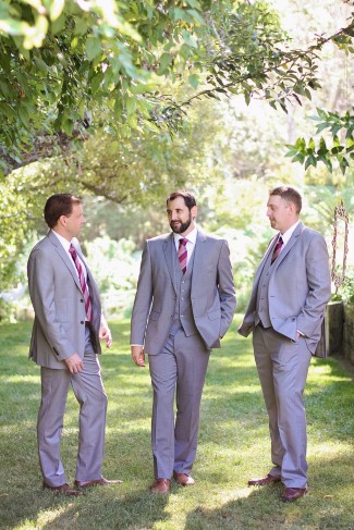 Groom with groomsmen wearing light gray suits