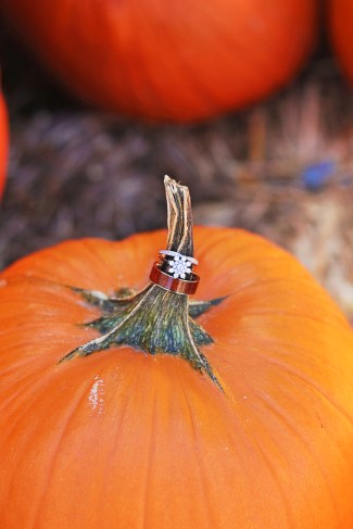 Snow flake shaped engagement ring on a pumpkin