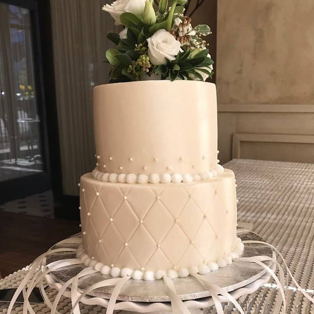 Wedding cake with traditional wedding cake pull charms